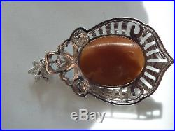 Master hand carved sardonyx cameo set into sterling silver pendant with cubic