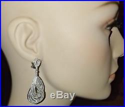 Pave Signty Cubic ZirconiaCZ Sterling Silver Interwoven Tear Hoop Omega Earrings