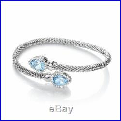 Sterling Silver Cross Over Bangle with Blue Topaz and Cubic Zirconias Pear Shape